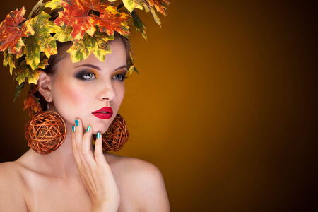 autmn: Beautiful woman with tree autmn ornament in head. Studio. Beauty and fashion. Young woman portrait with autmn tree concept Stock Photo