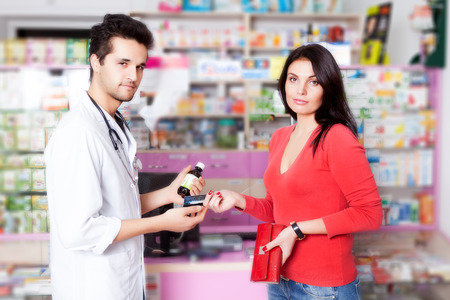 custumer: Pharmacist with client inside pharmacy. Custumer care. Healtcare. Medical business. Business style Stock Photo