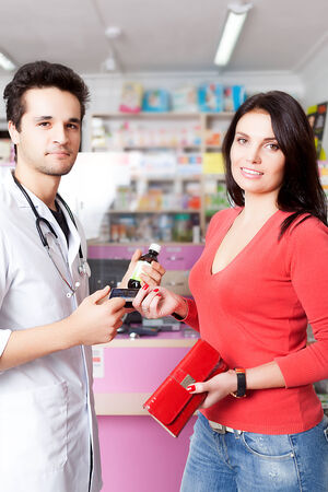 custumer: Pharmacist and client with products and credit card. Custumer care. Healthcare, medical and pharmaceutical stuff Stock Photo