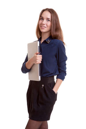 Smiling student with notebook in hands isolated over white background. Studio shooting photo
