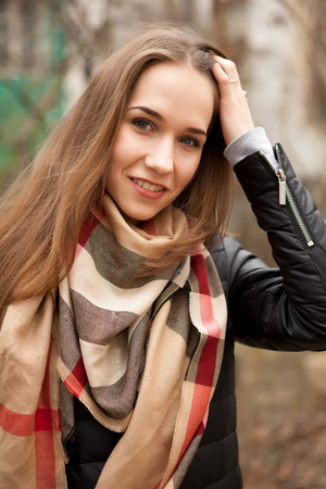 outside shooting: Young fashion girl smiling at camera outside shooting Stock Photo