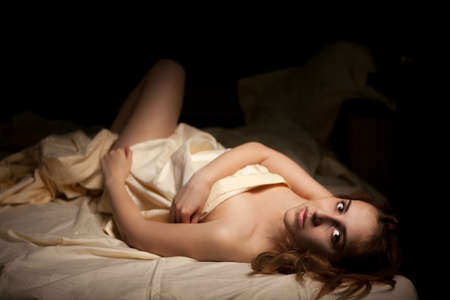 sex on bed: Sexy woman luying naked in bed covering her self with bed sheets