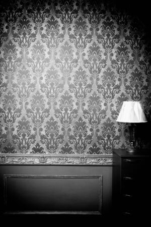 professional lighting: Luxury vintage interior with blue toning. Vignette. Studio professional lighting. Retro decor. Pattern wallpeper