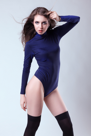 Sexy slim woman on studio background in body wear. Sensuality and sexuality. Beauty and fashion. Stock Photo
