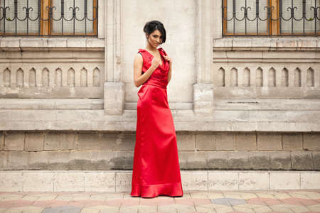 outside shooting: Gorgeous woman in red dress in fashion outside shooting