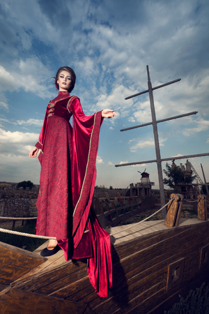 aristocracy: Woman in aristocratic clothes on boat in retro vintage concept. Elegancy and aristocracy. Rich woman from medieval period Stock Photo