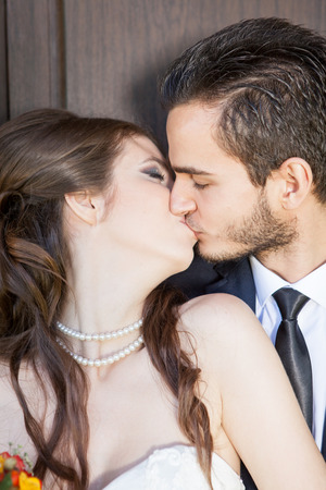 Bride and groom kissing each other. Happy familly. Wedding. Wedding photography. Weddin photo