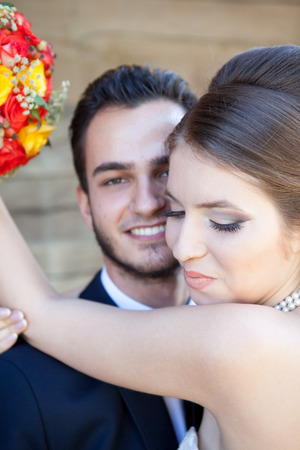 wedding photography: Bride smiling while embracing the groom. Happy familly. Wedding. Wedding photography. Weddin photo Stock Photo