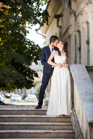 fellings: Wedding photosession of bride and groom in the city. Fellings. Love and passion
