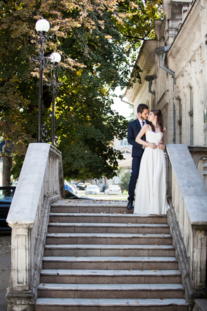 Wedding photosession of bride and groom in the city. Fellings. Love and passion
