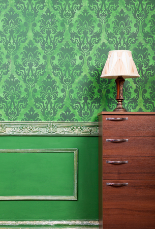 furniture home: Lamp on furniture in green vintage interior. Rich rococo period home. Interior photoshooting