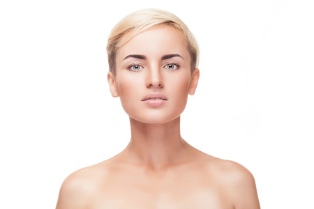 Young girl with no make up and perfect skin isolated over white background. Studio shooting. Beauty and make up. Make up advertising. Healthy clean skin