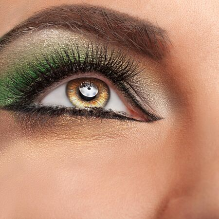 stage make up: Close up eye with green make up. Close up shooting. Beauty and fashion. Glamour and on stage make up. Make-up art Stock Photo