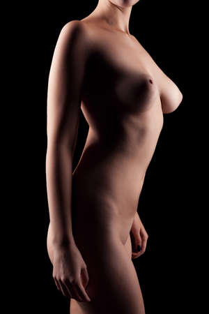 sensuality: Nude woman with perfect body on black background. Artistic art nude. Sensuality and sexuality. Beauty and art boudoir