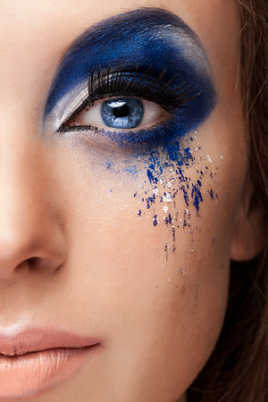 Blue art on stage fashion make up. Close up photo. Studio. Make up art and fantasy on stage blue make up