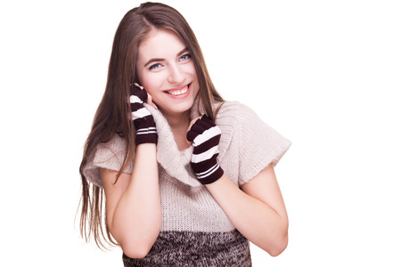 fingerless gloves: Preatty woman with fingereless glowes and winter clothes isolated over white background in studio shooting. Winter theme. Getting cozy and smiling at camera