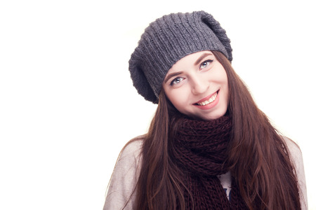winter photos: Girl with hat in winter clothes on white background in studio photos