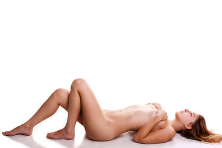 young girl nude: Sexy girl lying naked on white background with shadows casting from her hot body. Studio photos Stock Photo