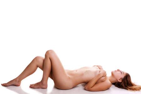 junge nackte m�dchen: Sexy M�dchen nackt auf wei�em Hintergrund mit Schatten von ihren hei�en K�rper Gie�en. Studio Fotos