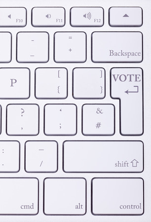 high end: VOTE word written on high end aluminium keyboard. Online election