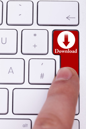 p2p: Finger pressing the red download button on keyboard. Torrent and p2p. Digital data transfer