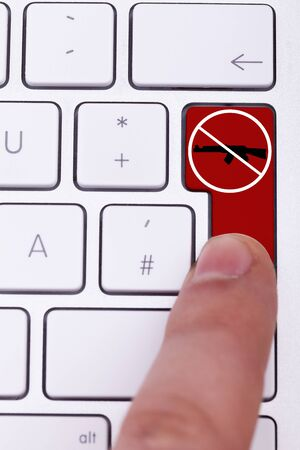 victim war: Finger pressing on stop gun sign on red button. Stop the crimes against civil people Stock Photo