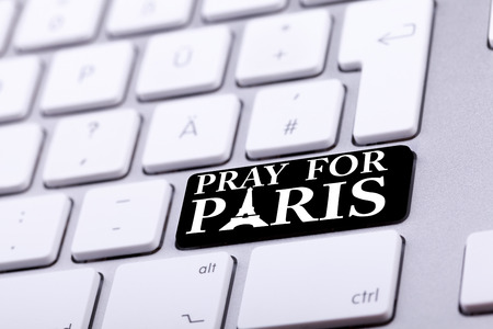 atack: Keyboard with pray for paris text and symbol. International support for france against terrorist atack from Paris