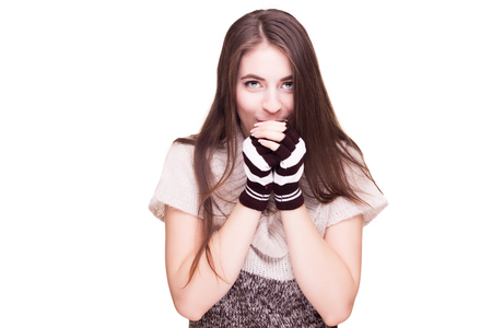 fingerless gloves: Woman blowing in her hands of cold isolated over white background in studio photo
