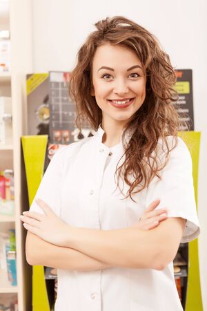 smilie: Pharmacist greeting clients with a smilie. Professional worker in medical system Stock Photo