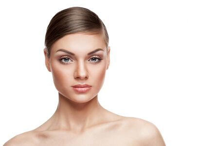 natural make up: Beautiful woman with natural make up isolated over white background. Studio photo. Nude makeup
