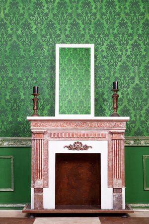 woden: Old vintage mirrod in woden frame on chimney on green vintage pattern background