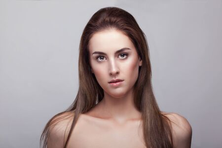 natural make up: Woman with natural make up on grey background in studio photo. Beauty and naturality. Healthy skin