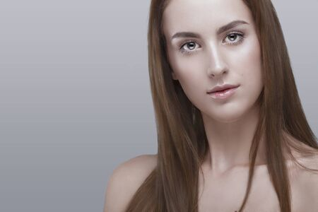 natural make up: Woman with natural make up on grey background in studio photo. Natural beauty.