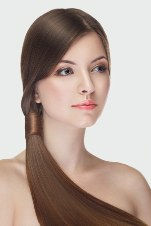 Beautiful girl with natural make up on white background in studio photo. Beauty and naturality