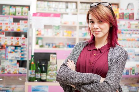 custumer: Custumer in sunglasess in front of pharmacy desk smiling