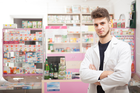 front desk: Pharmacist in front of the work desk. Healthcare business