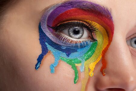 stage make up: Make up from color rainbow crying on the eye. Fashion on stage make up. Beauty extreme make up. Close up photo