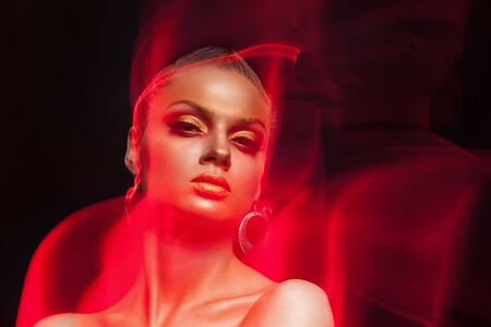 high end: Art fashion make up photo. Woman with fire type flames arround her. Artistic make up image. Beauty and fashion. High end image Stock Photo