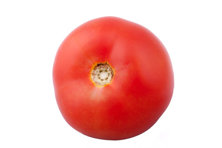 Fresh healthy tomato isolated over white backgorund. Raw food and healthy diet