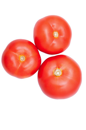 Three fresh healthy tomatoes isolated over white background. On top view. Healthy diet