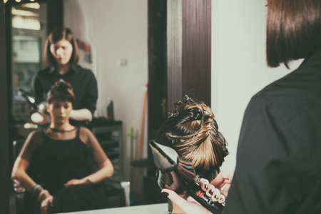 comb: Woman getting a hairstyle in the salon. Professional service. Beauty and treatment