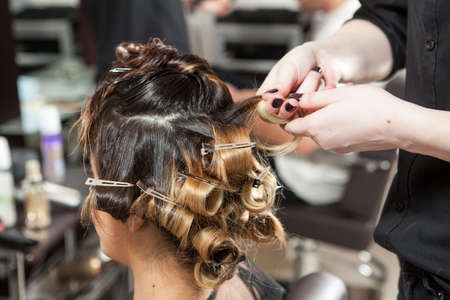 comb: Woman getting a hairstyle in salon. Professional service. Beauty and treatment Stock Photo