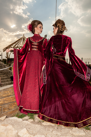 retro woman: Two sensual ladies in vintage clothes on a boat. Luxury and glamour Stock Photo
