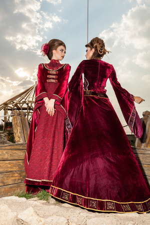 Gorgeous two ladies in vintage clothes on a boat. Luxury and glamour Stock Photo