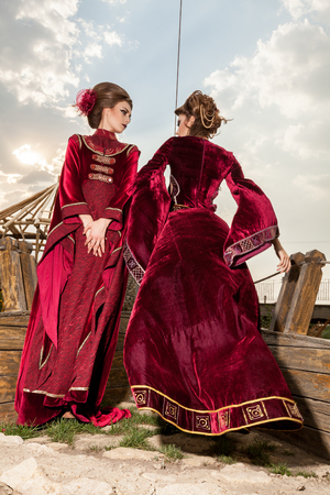 retro woman: Two ladies in luxury vintage clothes on a boat. Luxury and glamour