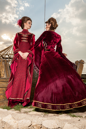 Two ladies in luxury vintage clothes on a boat. Luxury and glamour