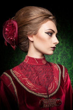 retro woman: Portrait of gorgeous woman dressed vintage clothes in retro interior. Rococo period. Luxury and high class Stock Photo