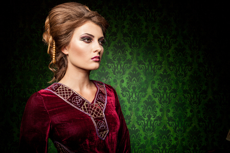 Attractive woman dressed vintage clothes in retro interior. Rococo period. Luxury and high class Stock Photo