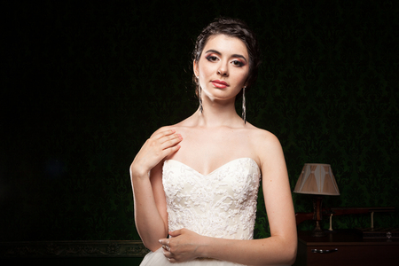 Beautiful bride in green vintage interior. Happiness and marriage Stock Photo