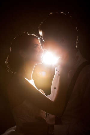 Beautiful Inlove bride and groom together backlit in vintage interior. Happiness and marriage Stock Photo